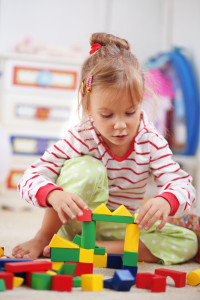 Child Therapy - Child Playing in Playroom